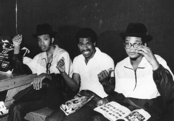Larry (middle) seen here with Run and DMC. 6/11/51-12/18/14